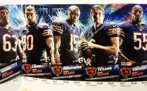 "No question about it, the Bears get the award for most intimidating statures. I mean Jay Cutler looks about ready to pop that pigskin with his bare hands. They're looking at us like ""You better keep this ticket…or else."""