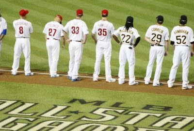 Major League Baseball players standing side-by-side waiting for the start of the MLB All-Star Game
