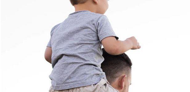 Kid on Dad's shoulders